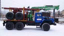 Лесовозный тягач Урал 55571, с гидроманипулятором с роспусками