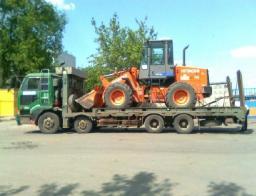 Услуги эвакуатора для спецтехники и грузовиков