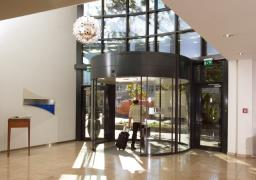 Изогнутые раздвижные двери для отдельных входных зон Dorma Bst/Fbst