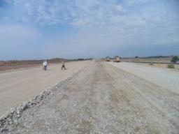 Устройство основания дороги из ПГС (песчано-гравийная смесь)