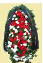 Венок на кладбище из живых цветов