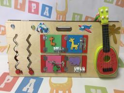 Двухсторонний бизиборд с музыкальными инструментами
